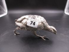 A WHITE METAL FIGURE OF A GROUSE, REALISTICALLY MODELLED WITH INTRICATELY CHASED FEATHERS. LENGTH