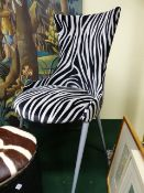 A CONTEMPORARY SIDE CHAIR BY CATELAN ITALIA WITH FAUX ZEBRA STRIPE UPHOLSTERY, ANOTHER MODERN