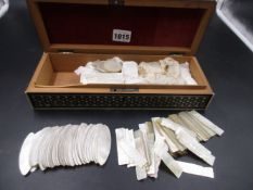 AN INDIAN SANDALWOOD BOX CONTAINING APPROXIMATELY 295 VARIOUS CHINESE MOTHER OF PEARL COUNTERS.