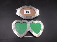 A CHINESE SILVER DOUBLE HEART PHOTO FRAME ENGRAVED WITH BAMBOO DECORATION TOGETHER WITH A SIMILAR