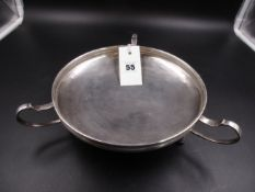 AN EDWARDIAN ART NOUVEAU SILVER HALLMARKED FOOTED AND HANDLED BOWL. DATED 1912 FOR SAUNDERS AND