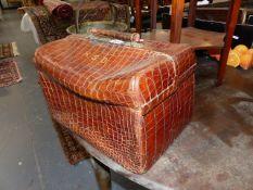 AN EARLY 20th.C.CROCODILE HIDE DRESSING CASE OF GLADSTONE BAG FORM. W.39cms.
