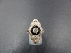AN 18ct WHITE GOLD BLACK AGATE AND DIAMOND RING. THE CENTRAL BRILLIANT CUT DIAMOND HAS BEEN INSET