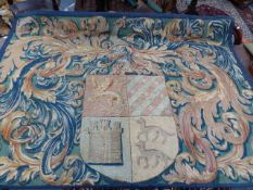 A 17th / 18th.C. ARMORIAL TAPESTRY, THE CENTRAL CREST WITH SURROUNDING FOLIATE MOTIFS. 206 x