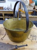 TWO BRASS BOAT TYPE LANTERNS, A LARGE BRASS JAMPAN, BELLOWS AND A LACQUER DECORATED CAKESTAND.