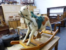 AN UNUSUAL TAXIDERMY GOAT MOUNTED ON ROCKERS WITH LEATHER SADDLE AND HARNESS. WIDTH OF FRAME