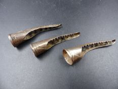 THREE CHINESE SILVER FINGER NAIL PROTECTORS.