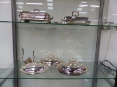 FIVE ANTIQUE AND LATER SILVER PLATE COVERED ENTREE DISHES OF VARYING DESIGN TO INCLUDE A PAIR OF