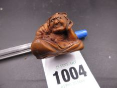 A JAPANESE CARVED WOOD NESTUKE OF A SEATED MYTHICAL FIGURE, SIGNED. H.3cms.