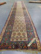 AN ANTIQUE PERSIAN TRIBAL RUNNER. 562 x 110cms.