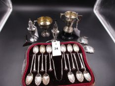 A CASED SET OF TWELVE VICTORIAN FLUTED TEA SPOONS AND A PAIR OF MATCHING SUGAR TONGS, DATED 1893 FOR