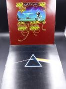 RECORDS. PINK FLOYD, THE DARK SIDE OF THE MOON WHICH INCLUDES TWO POSTERS AND THREE STICKERS, PINK