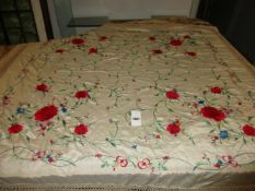 A LATE 19th/ EARLY20th.C.CHINESE CREAM SILK SHAWL EMBROIDERED WITH COLOURED FLOWERS.