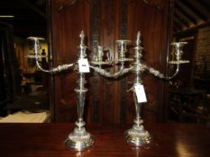 A PAIR OF OLD SHEFFIELD PLATE THREE LIGHT CANDELABRA, THE CENTRAL LIGHT TO EACH REMOVABLE BRANCH