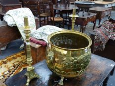 A GROUP OF ANTIQUE AND LATER BRASSWARES TO INCLUDE AN EMBOSSED JARDINIERE, A PAIR OF CANDLESTICKS,