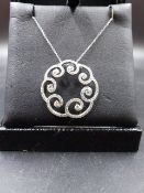 AN 18ct WHITE GOLD AND DIAMOND FILIGREE SWIRL DESIGN PENDANT SUSPENDED ON A 18ct WHITE GOLD SQUARE