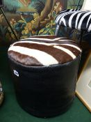 A VINTAGE LEATHER AND ZEBRA HIDE POUFFE STOOL. Dia.40cms