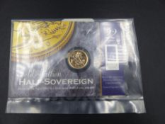 A SEALED 22ct GOLD PROOF HALF SOVEREIGN, DATED 2000.