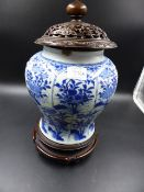 A CHINESE BLUE AND WHITE BALUSTER VASE WITH CARVED HARDWOOD STAND AND COVER. OVERALL H. 33cms.