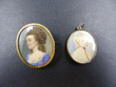 TWO PORTRAIT MINIATURES TO INCLUDE AN ANTIQUE YELLOW METAL MOUNTED OVAL BROOCH DEPICTING A