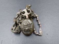 AN ANTIQUE VULCANITE MOURNING LOCKET AND CHAIN CONTAINING A PORTRAIT OF A LADY IN 19th C. DRESS.