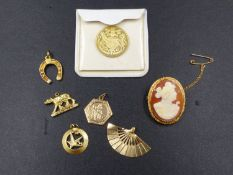 FIVE GOLD CHARMS. A 15ct GOLD PORTRAIT CAMEO AND A 9ct GOLD HALLMARKED SILVER JUBILEE