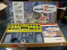 A VINTAGE PHILLIPS MECHANICAL ENGINEER CONSTRUCTION SET IN A WOODEN SLIDE TOP BOX.