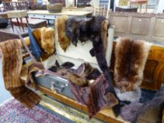 A GROUP OF VARIOUS ANTIQUE AND LATER FUR STOLES, COLLARS AND A CAPE TOGETHER WITH A VINTAGE ICE AXE,