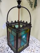 AN ANTIQUE BRASS FRAMED HALL LANTERN WITH LEADED STAINED GLASS PANELS. H.64cms.