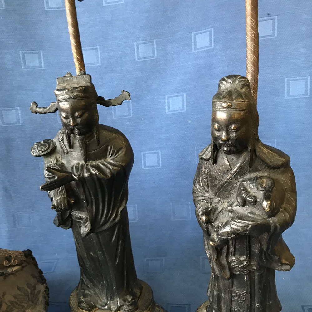 Lot 59 - Pair of C19th Chinese bronze figures raised on decorative oval stands, as table lamps with shades