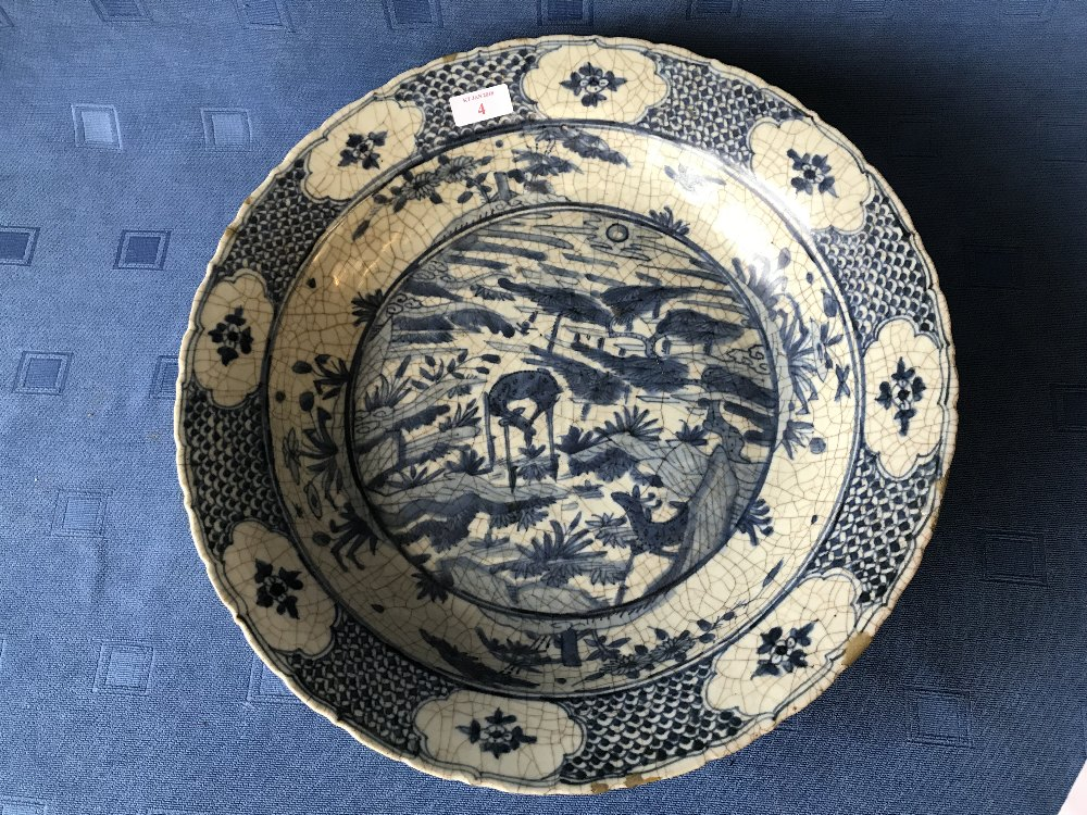 Lot 4 - Chinese blue and white circular crazed dish decorated with scenes of animals & flowers with