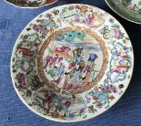Lot 49 - Chinese famille rose circular shallow dish entirely decorated with scenes of figures & flowers, 26cm