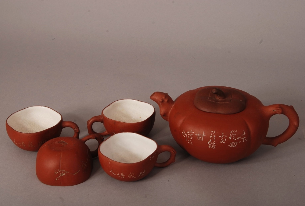 Lot 30 - C20th Chinese Zisha teapot and cover, of compressed and ribbed form, decorated with prunus and