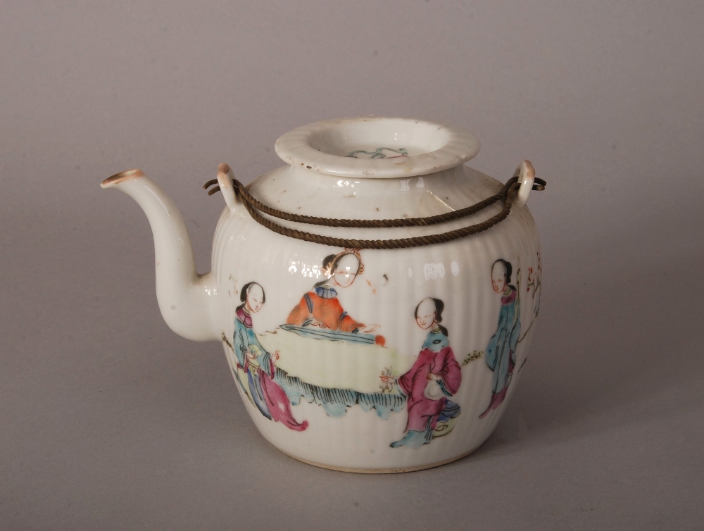 Lot 22 - C19th Chinese famille rose teapot and cover, painted with ladies in a courtyard, 18cm wide