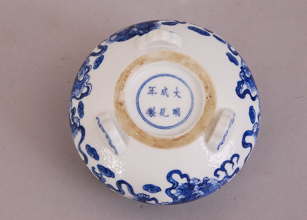 Lot 16 - C19th Chinese blue and white tripod censer, painted with four lions at play, two loop handles rise
