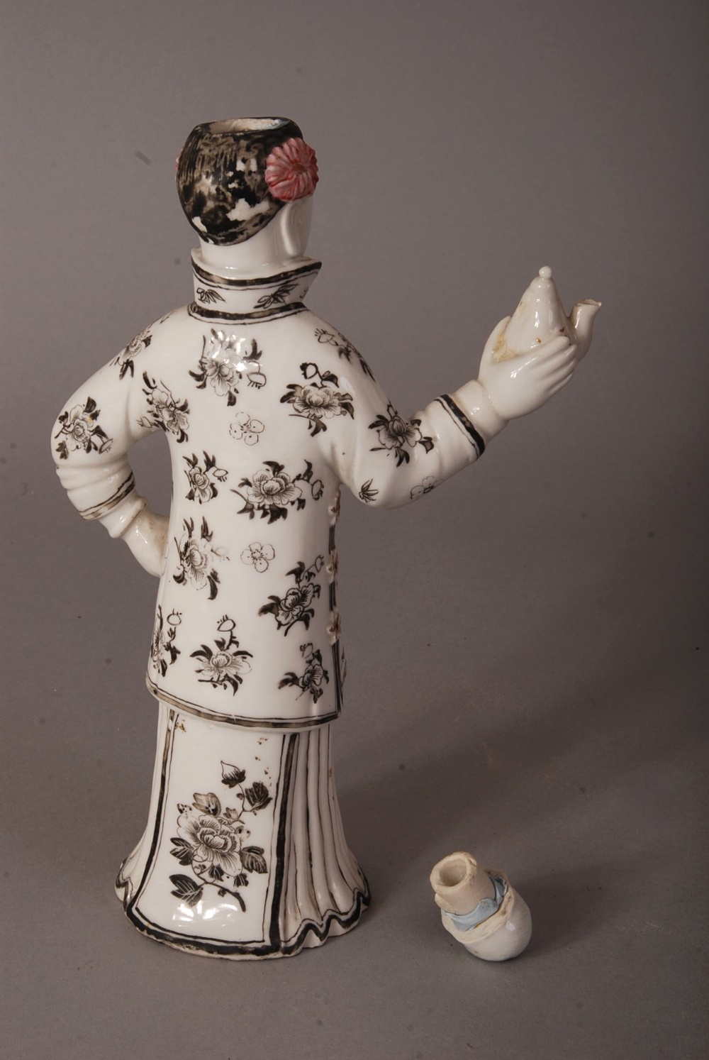 Lot 42 - C19th/20th Chinese white glazed lady-form teapot and cover, painted in black and red with floral