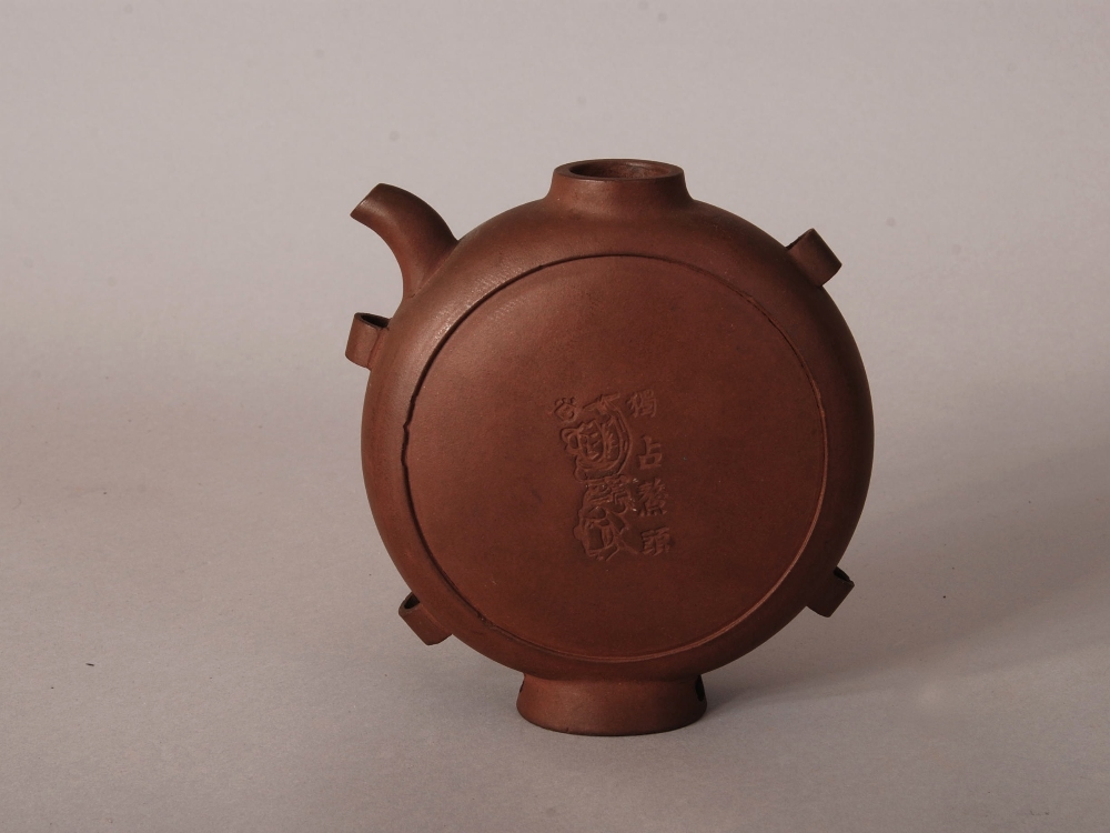 Lot 28 - C19th Chinese Zisha teapot, of flattened circular form and with four handles, incised to both