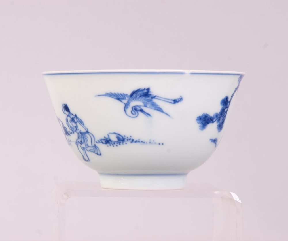 Lot 4 - Chinese blue and white bowl, painted with a scholar leaning against a pine tree watching cranes,