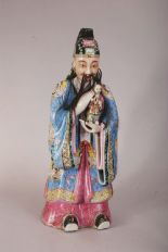 Lot 43 - Large C18th/19th Chinese famille rose figure of a dignitary, holding a child and wearing long