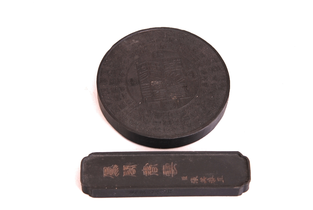 Lot 20 - 2 C19th Chinese ink cakes, one of circular form, and the other of rectangular form (2)