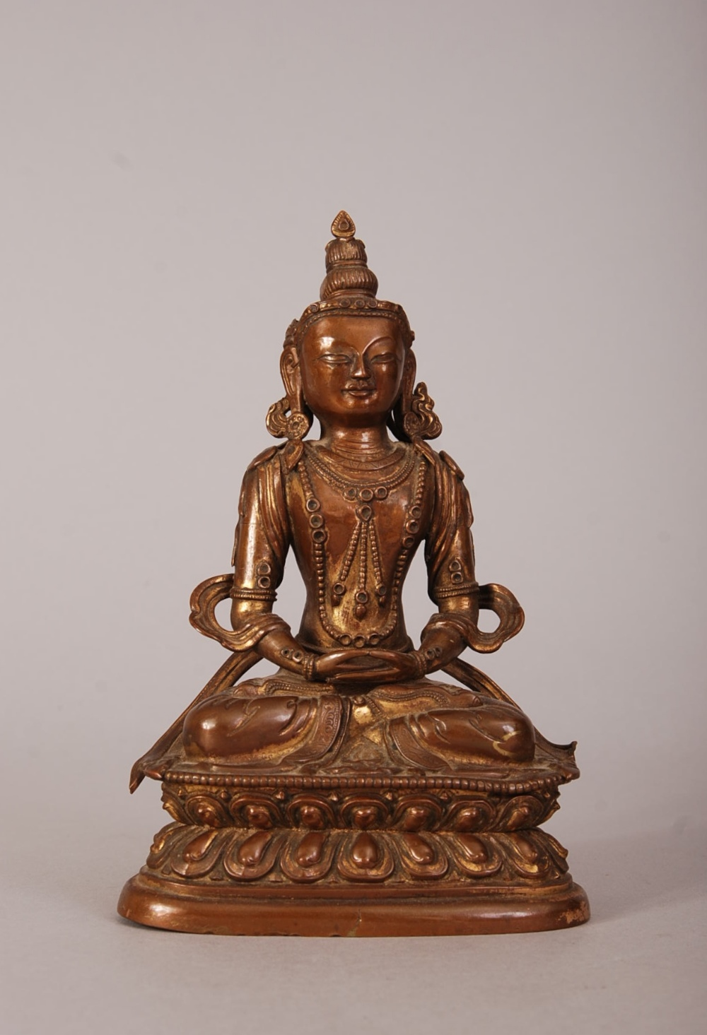 Lot 56 - C18th Chinese gilt-bronze figure of Buddhist, seated in dhyanasana on a double-lotus base with the