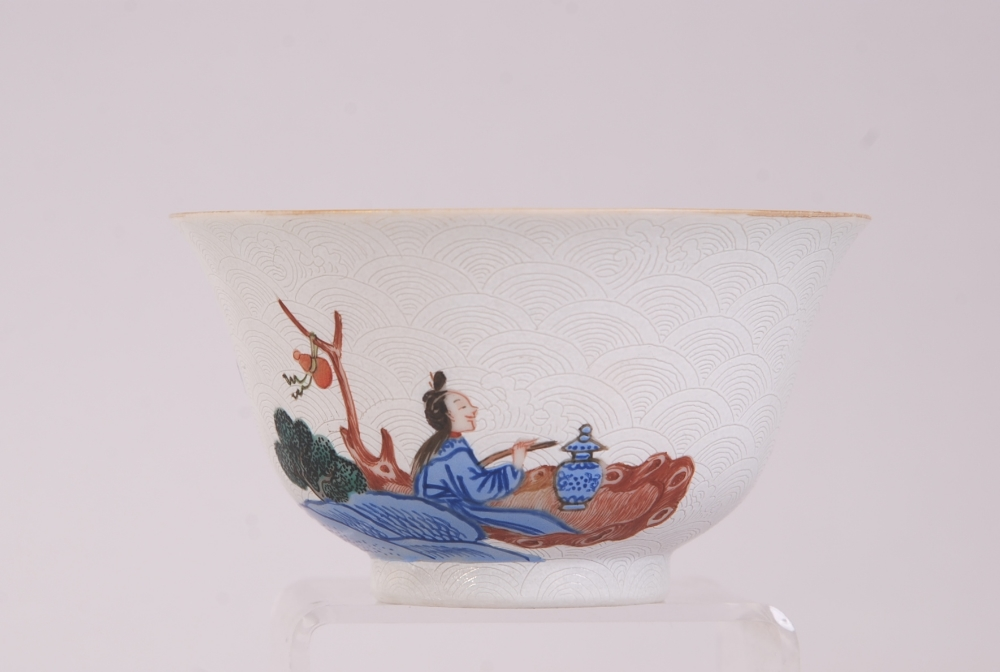 Lot 12 - C19th Chinese famille rose sgraffito bowl, painted with figures in a riverside landscape scene,