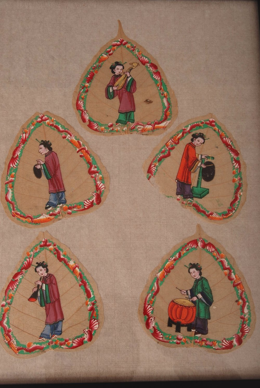 Lot 49 - C19th Chinese mounted set of five Bodhi leaf paintings, each painted to depict a lady playing