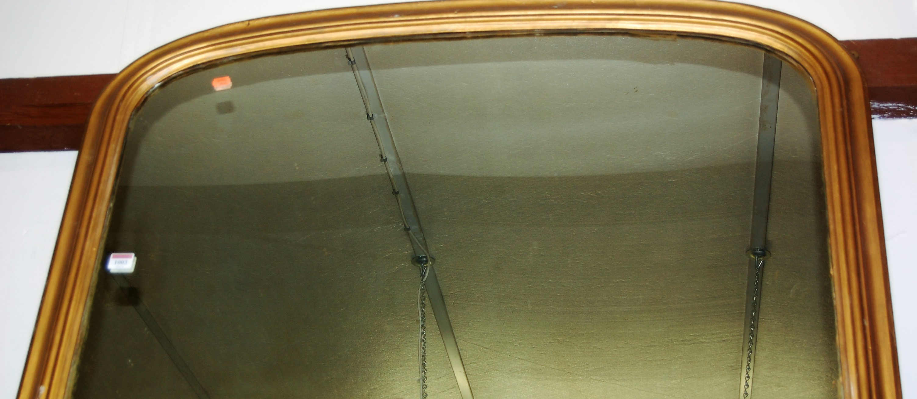 Lot 1003 - A Victorian overmantel mirror, the frame being later gilt painted, w.122cm