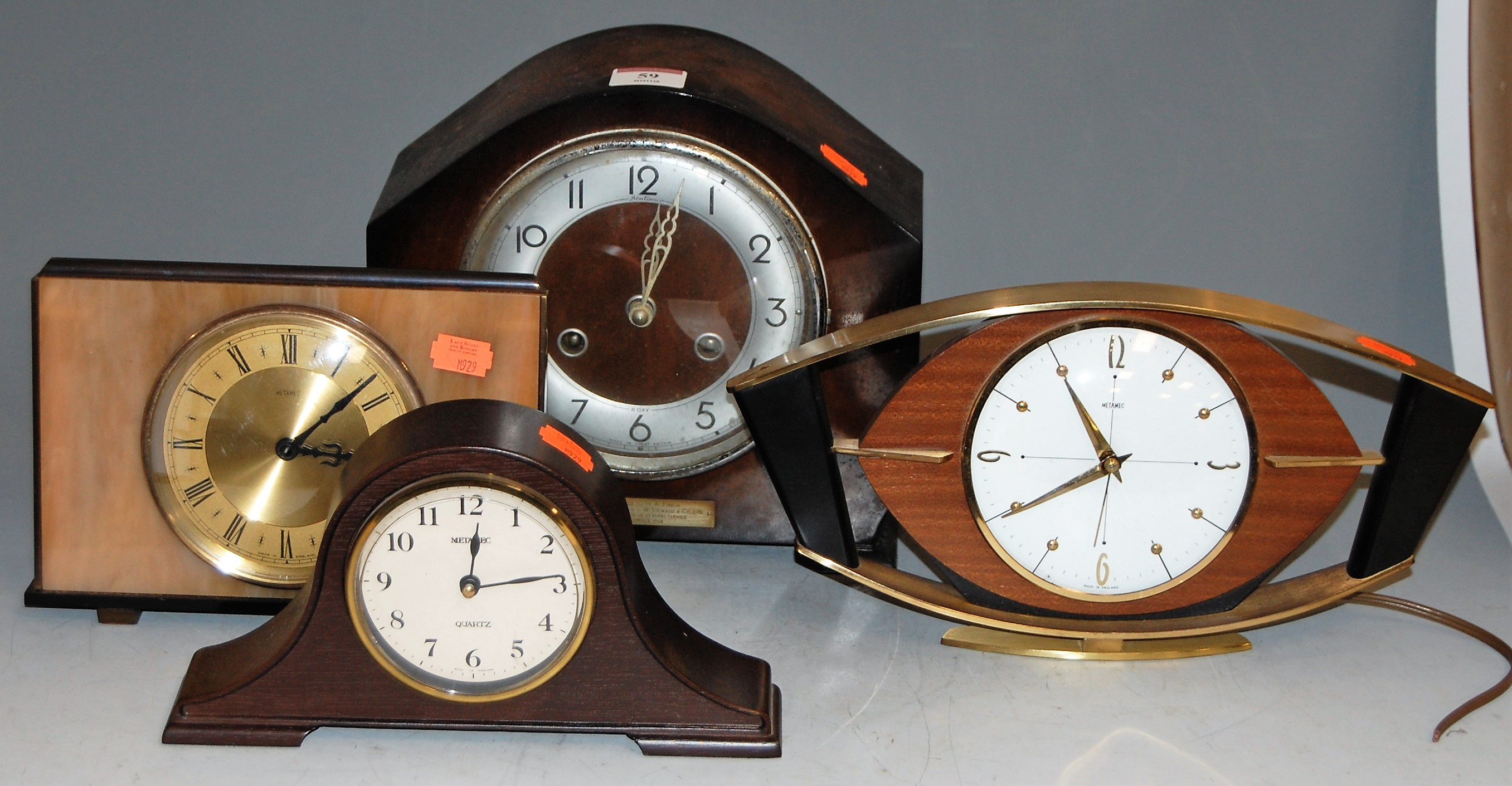 Lot 59 - A 1950s oak cased mantel clock; together with three others (4)