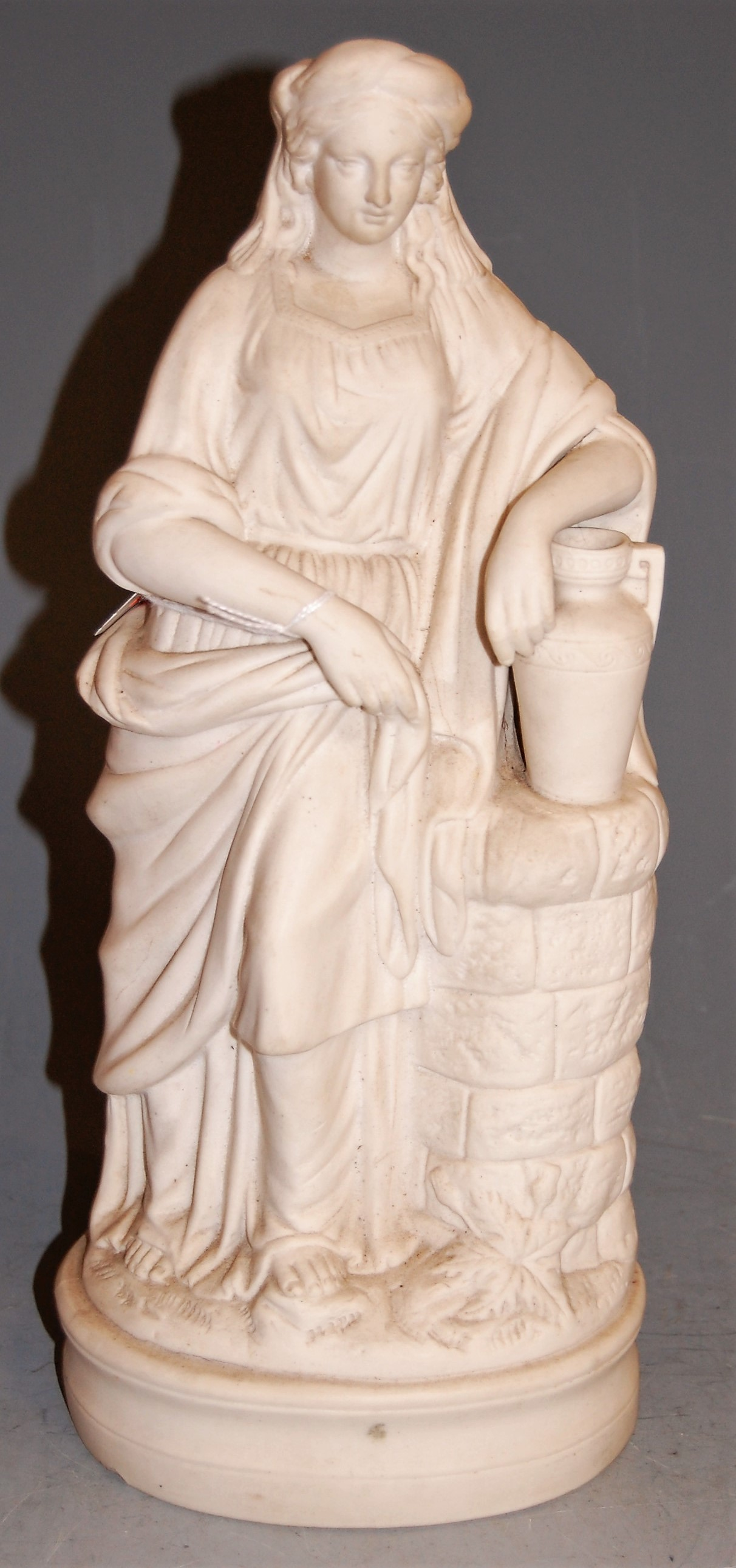 Lot 23 - A Victorian parian figure of a lady in standing pose, h.34cm