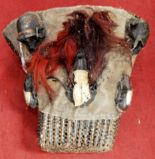 Lot 3 - A late 19th/early 20th century Kanyak 'head-taking' basket with monkey skulls, Nagaland, Assam,