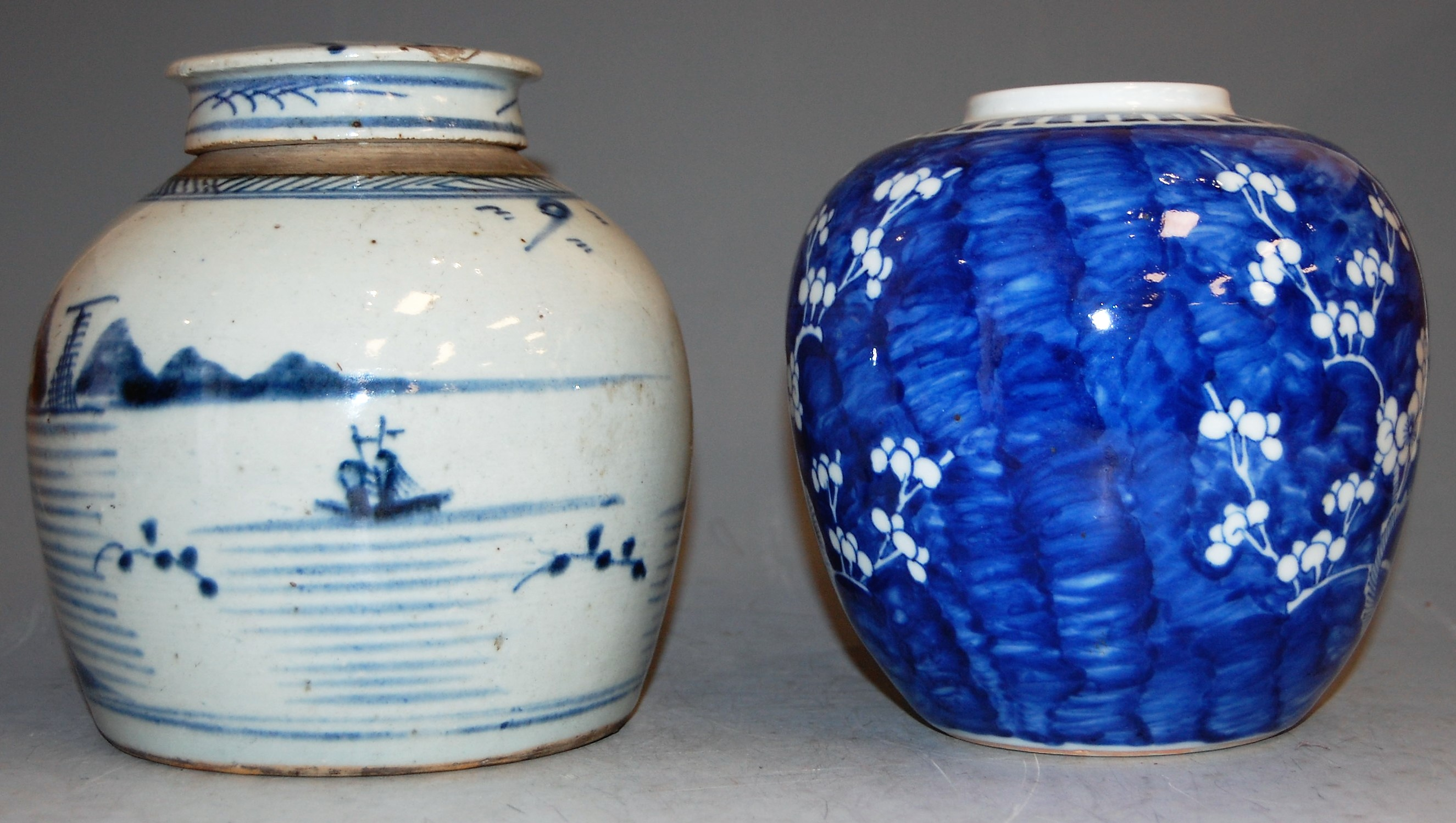 Lot 55 - A 19th century Chinese stoneware blue and white ginger jar and cover, h.18cm; together with one