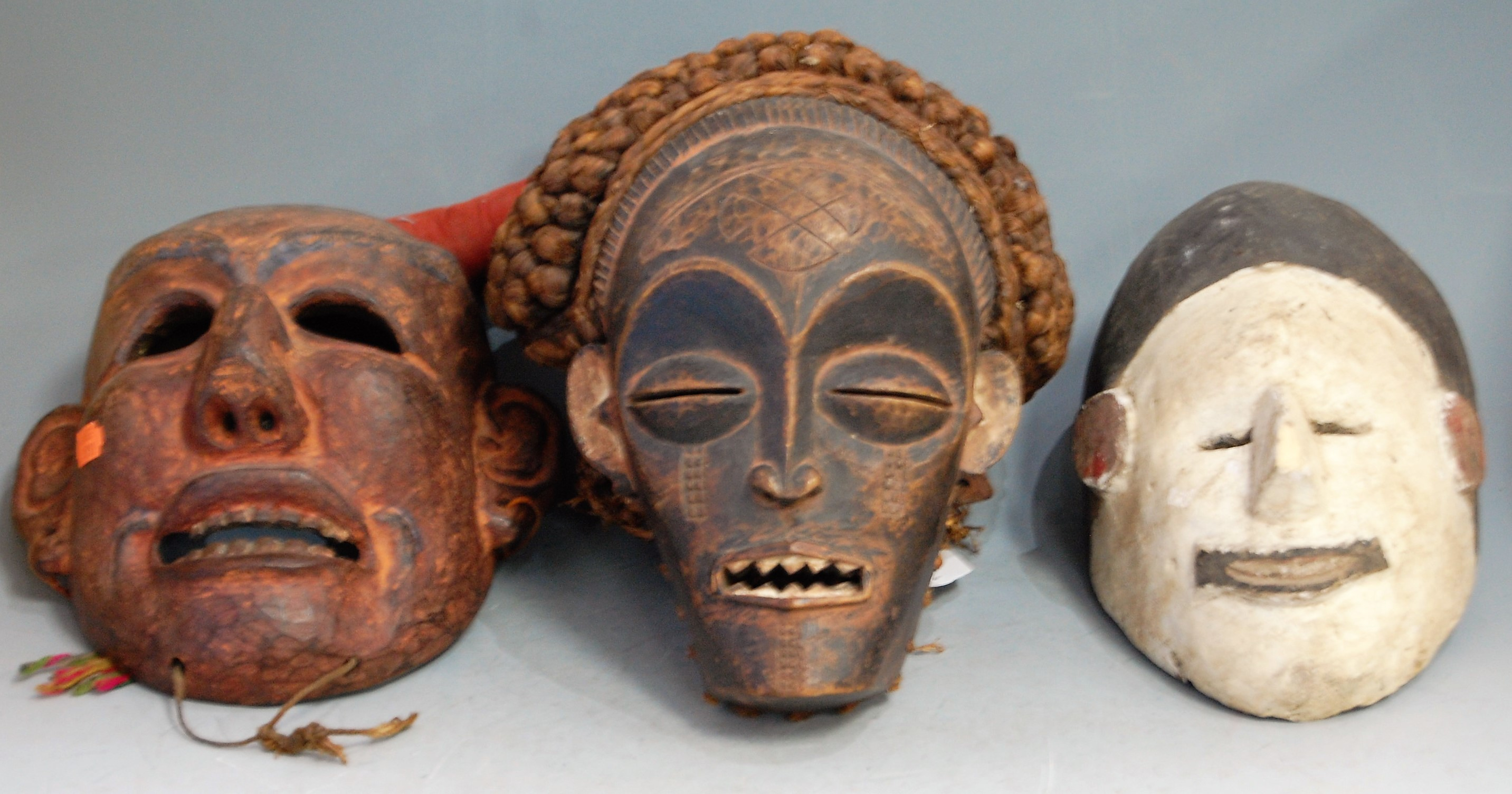 Lot 6 - Two mid-20th century African masks, comprising Punu (Gabon) and Chokwe (Angola), the largest 31 x