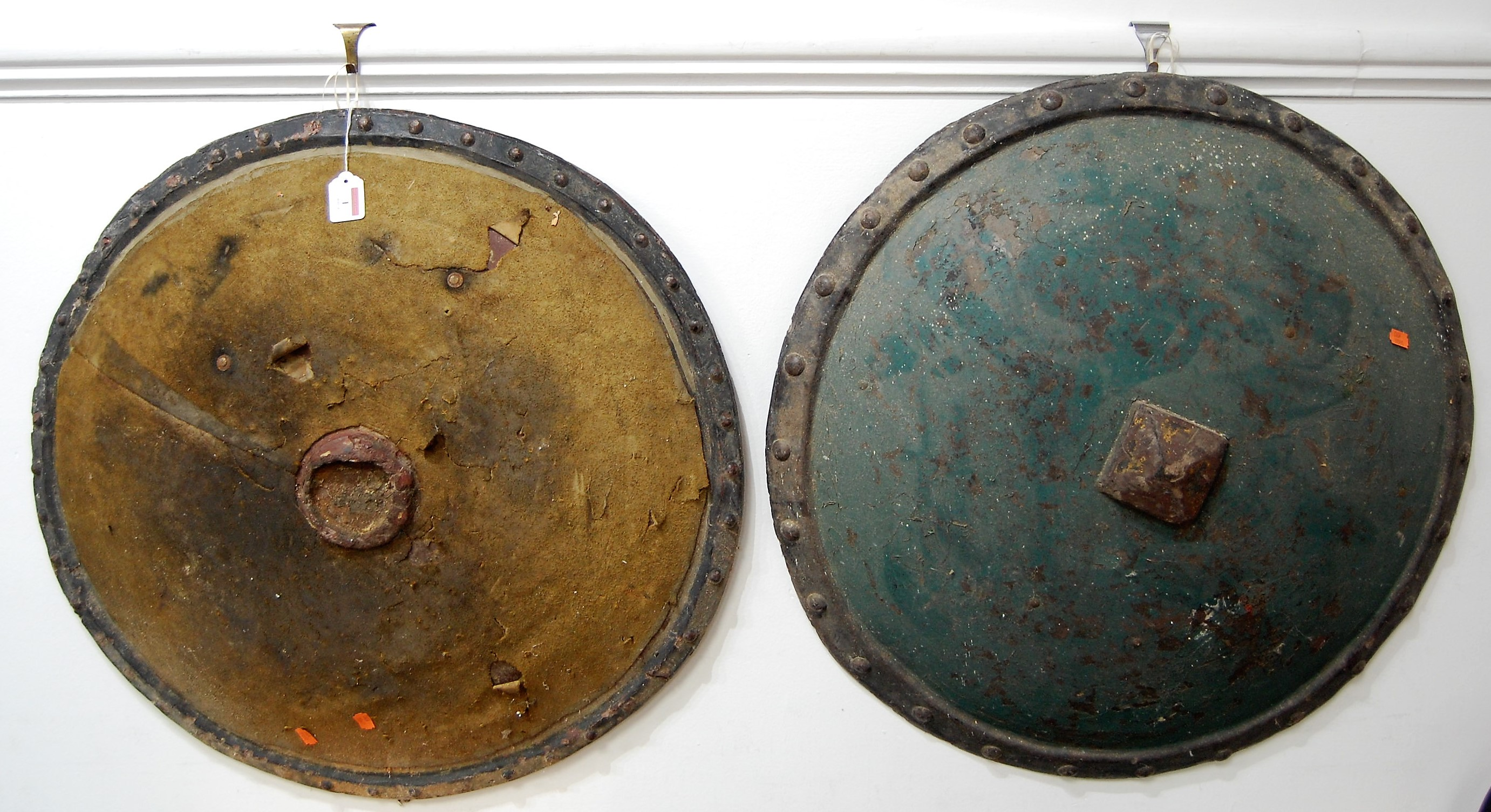 Lot 1 - A 19th century Ethiopian / Sudanese hide covered shield, of circular form, having studded rim,